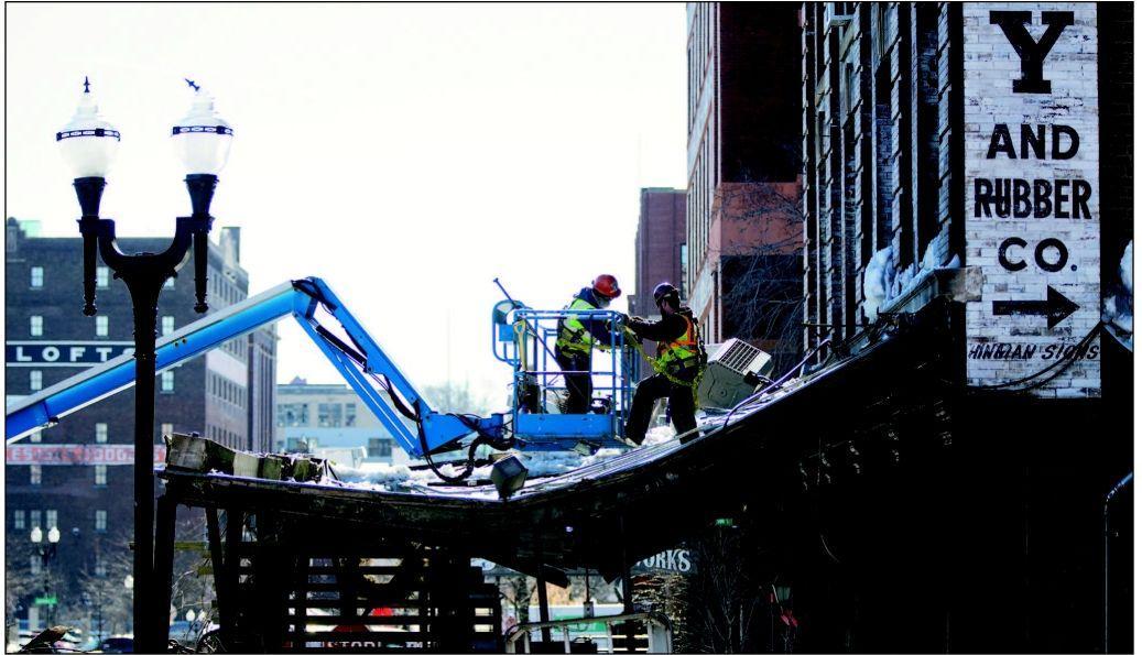 M's Pub awning falling to excavators