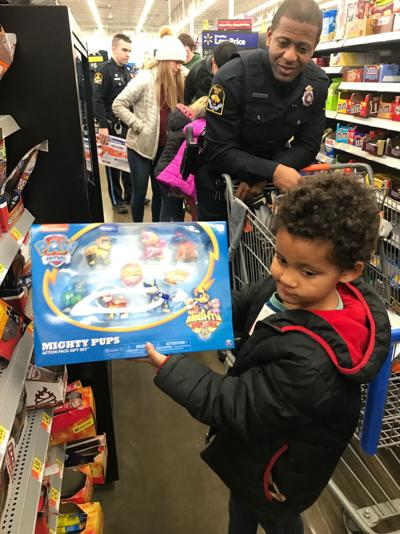 Omaha police officers juggle 55 kids as they shopped and visited Santa during Shop with a Cop