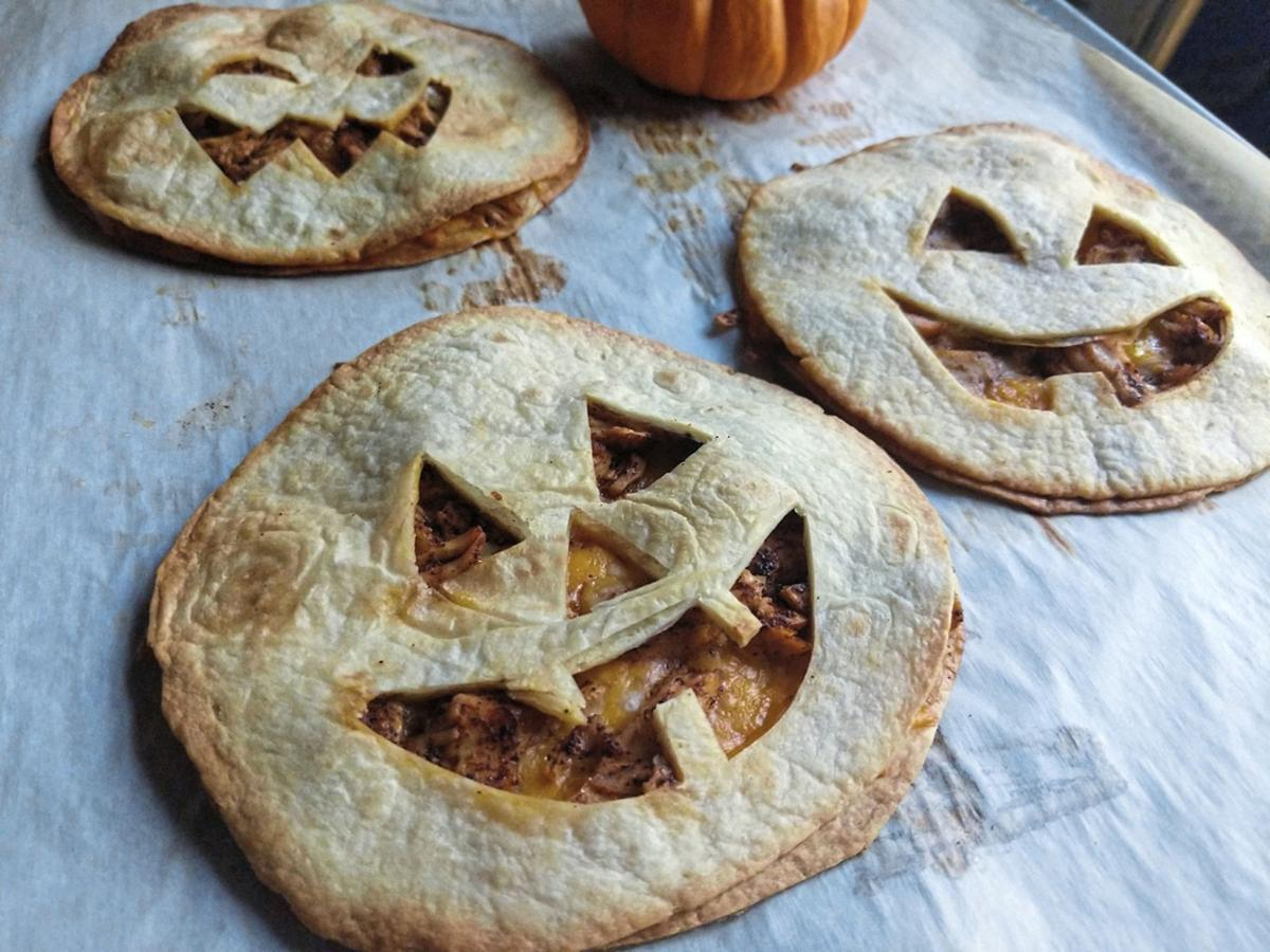 Stuffed with chicken and cheese, jack-o'-lantern quesadillas make a quick and easy dinner on Halloween.