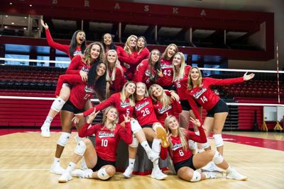 With new team and motto, coach John Cook's Huskers aim to keep it going