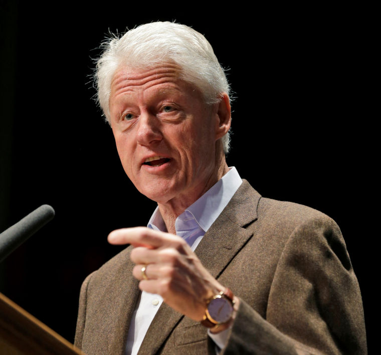 Clinton urges Obama to yield a bit on health law