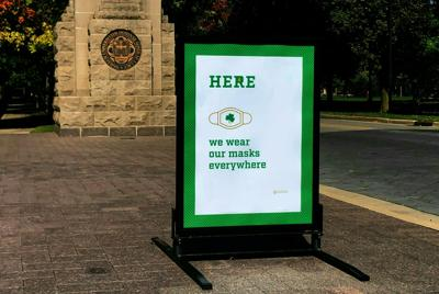 A sign asking to wear masks is seen on the campus of Notre Dame University in South Bend, Indiana on October 6, 2020. In June, Laurence Steinberg, a professor of psychology at Temple University, predicted that students returning to college campuses during a pandemic would not go well.
