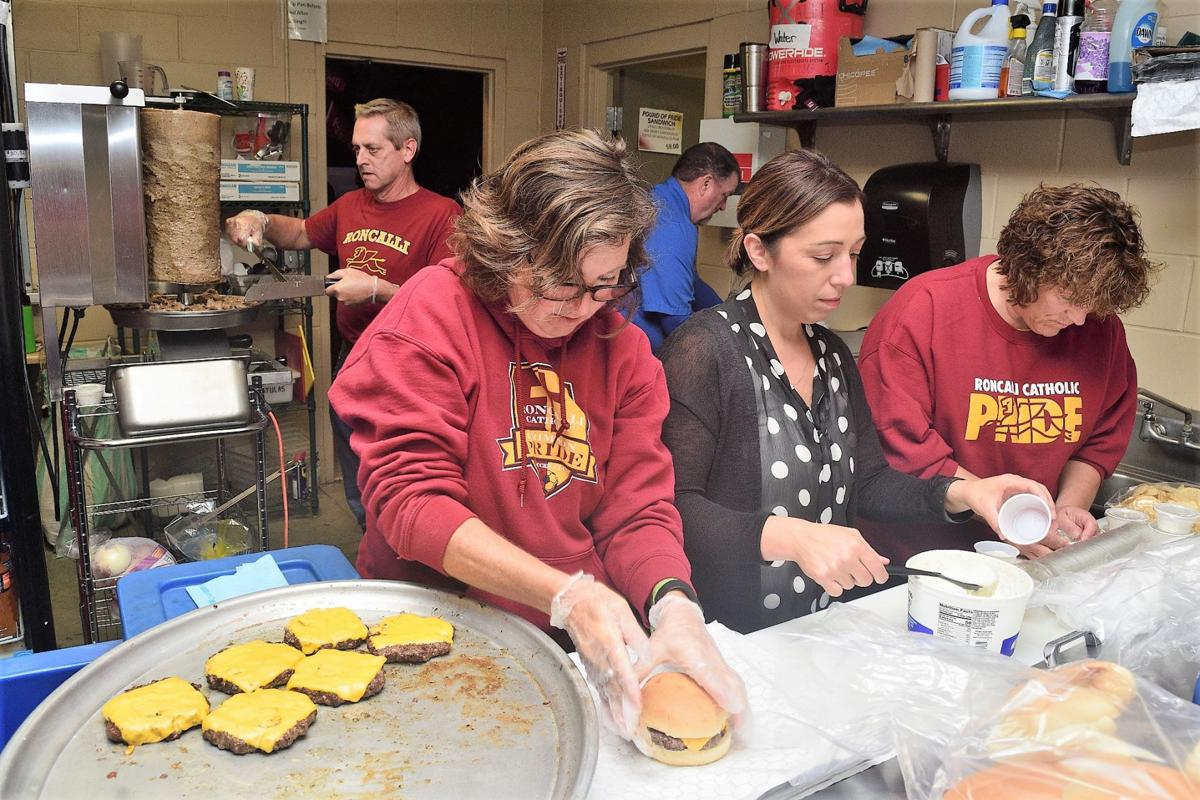 Roncalli boosters hustle to handle the half-time rush at the concession stand