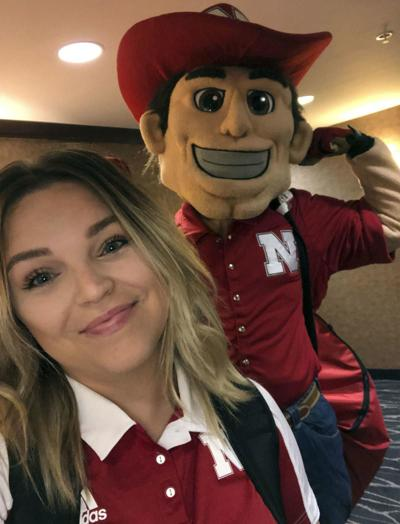 Former Ralston cheerleader takes leap to help coach Husker squad, reintroduce stunting