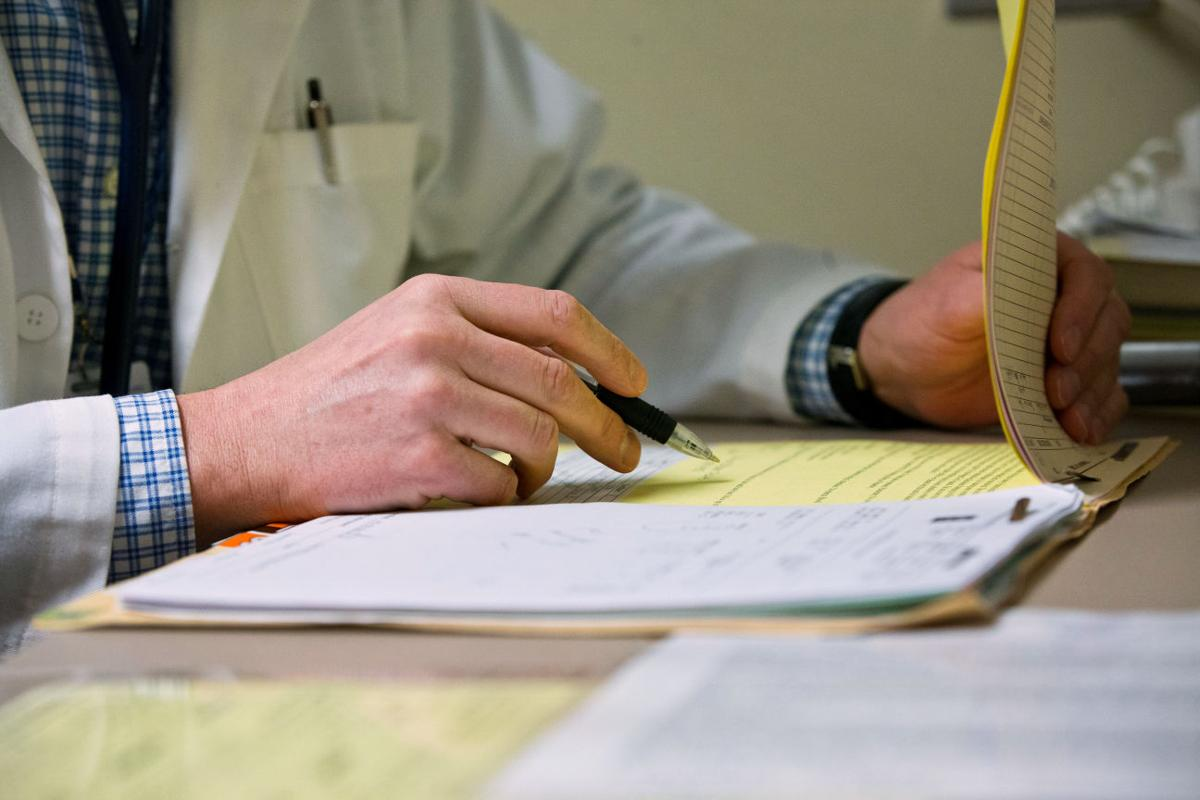 Doctor checks medical chart
