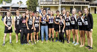 Omak cross country runners bring home hardware from Manson