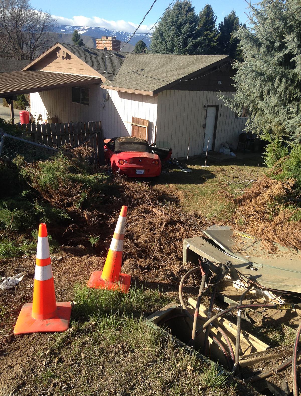 Boy crashes BMW into home