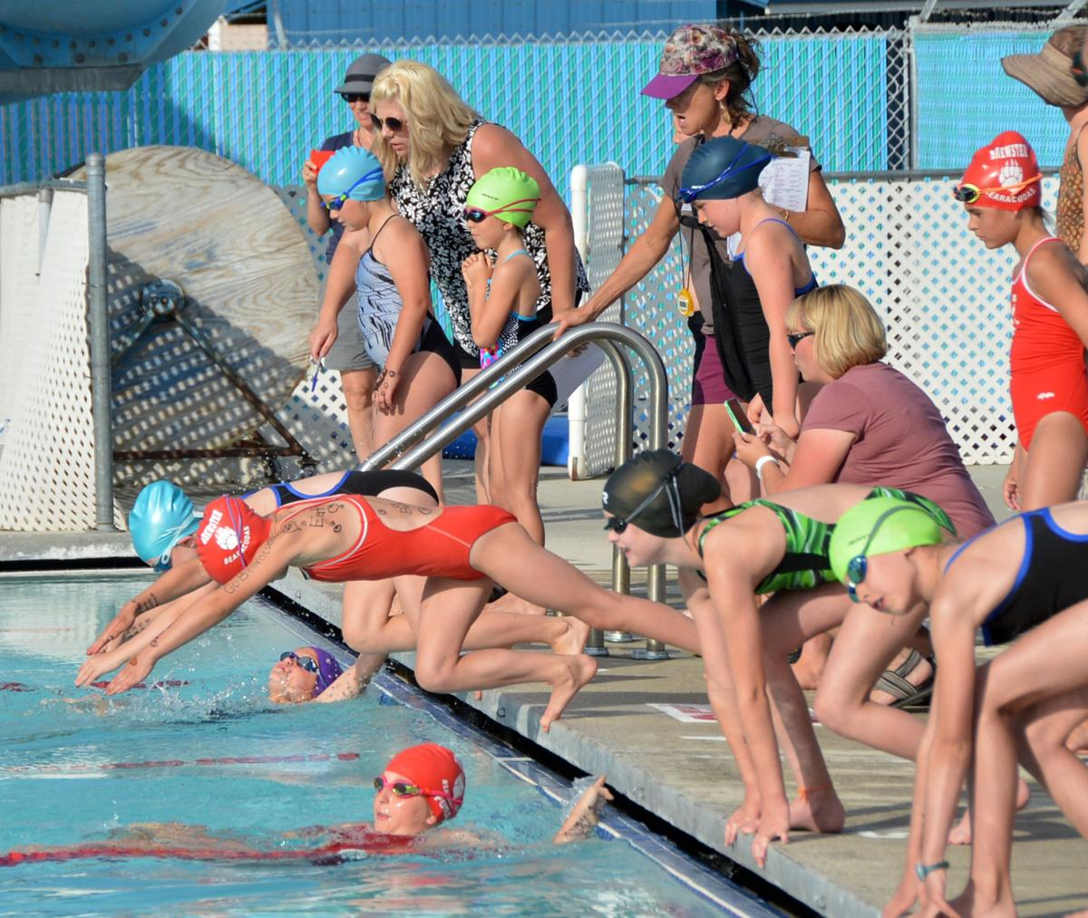 Swimmers dive