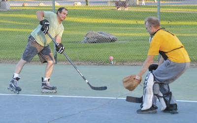 Rollerblade hockey in the park