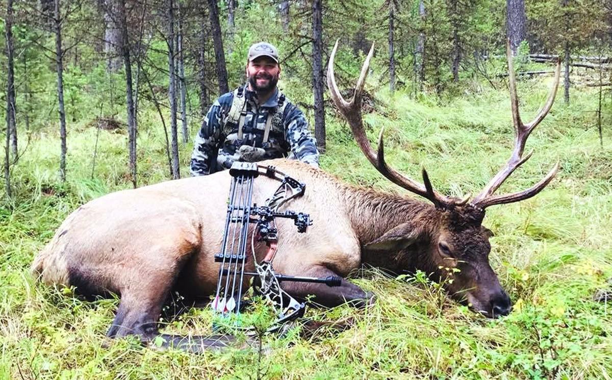 Jerrod Gibbons poses with an elk