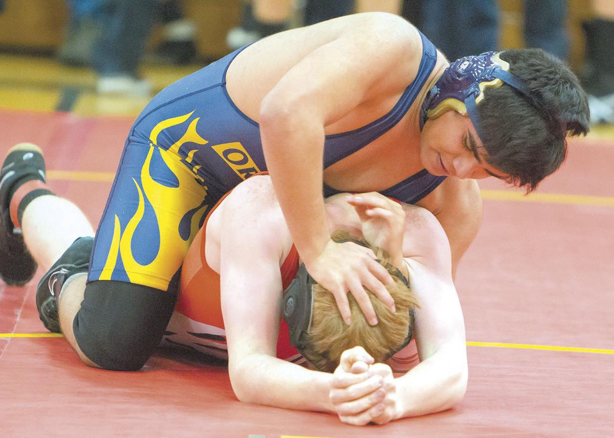 Wrestlers pin down holiday tourneys
