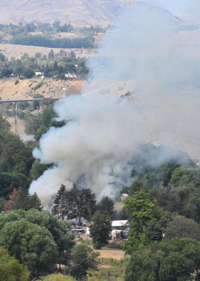 Three injured in fire near Omak