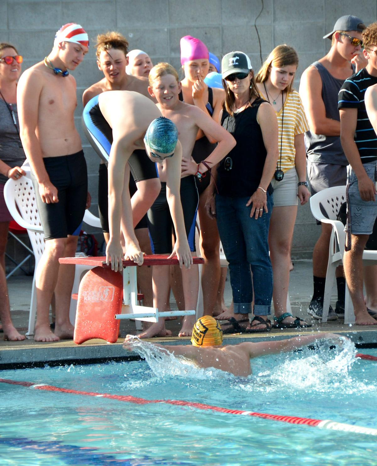 Swimmer gets ready to dive into Brewster pool during relay