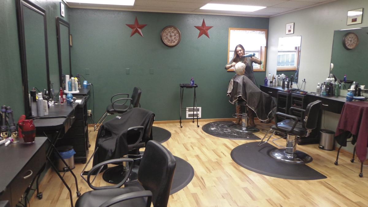 Expressions Hair Design and Day Spa celebrates move