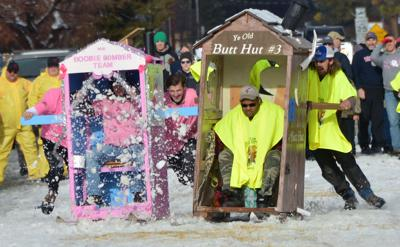 Outhouses flow down Main Street