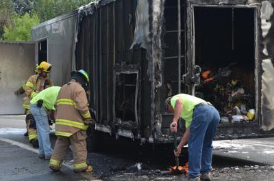 Trailer catches fire on Highway 97