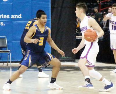 Anthony Jamison guards a Willapa Valley