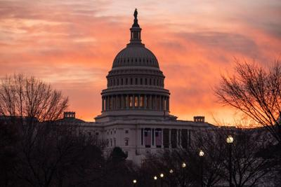 Dawn breaks at the Capitol in Washington, Monday, Jan. 11, 2021