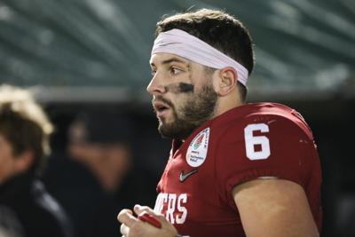 9adc982e7 Senior quarterback Baker Mayfield walks off the field after the Sooners  fall to Georgia in the Rose Bowl Jan. 1.