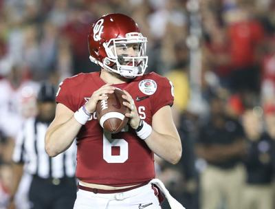 270c75699 Baker Mayfield. Senior quarterback Baker Mayfield looks for a teammate to  pass the ball to during the Rose Bowl against Georgia Jan.