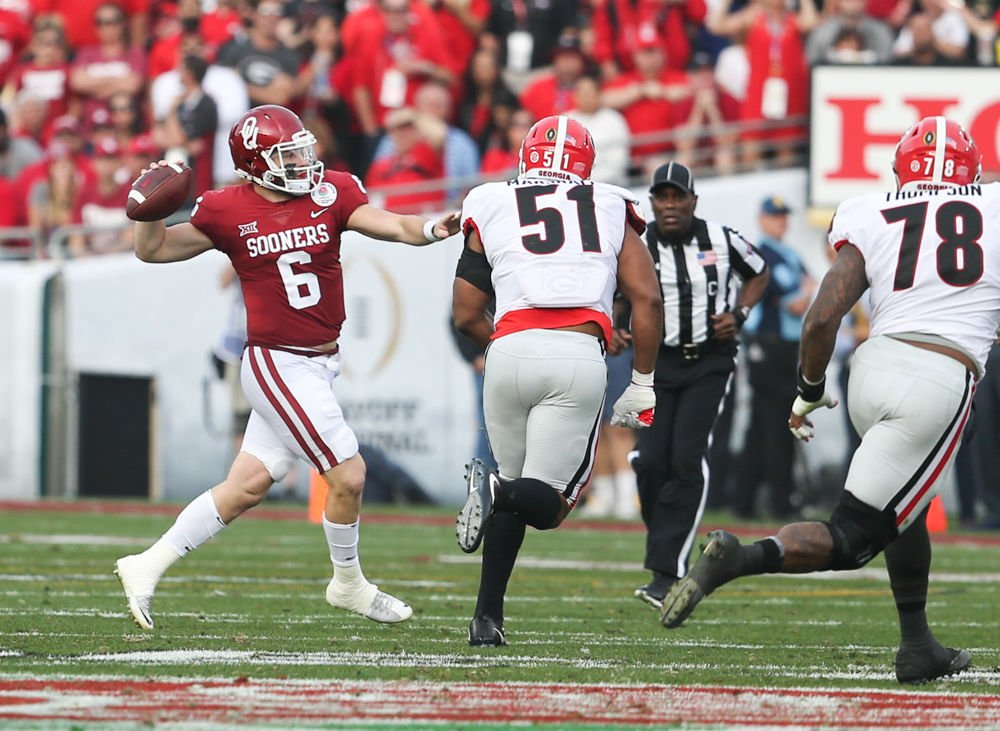 62f96acc0 Baker Mayfield. Senior quarterback Baker Mayfield throws the ball during  the Rose Bowl against Georgia Jan.