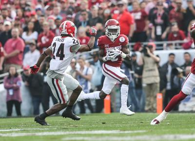 27d862cfd Sophomore wide receiver Marquise Brown runs the ball during the Rose Bowl  against Georgia Jan. 1.