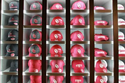 227fa491b046d5 Baseball caps of many different styles for sale in the new Sooner Shop  April 4.