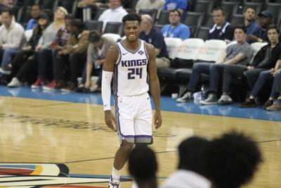 b2a297320bc NBA shooting guard Buddy Hield smiles to his team during game against the  Oklahoma City Thunder Oct. 21.