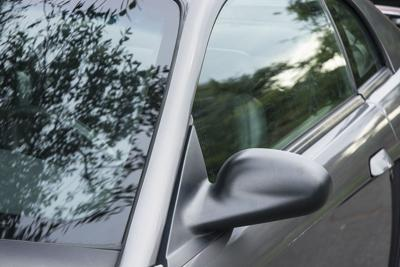 Shiny Silver Car Exterior Windshield And Side Mirror. Photo Credit: JonGorr (iStock).