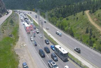 An image of traffic backed up in westbound lanes of I-70 near Genesee. Photo Credit: CDOT website.