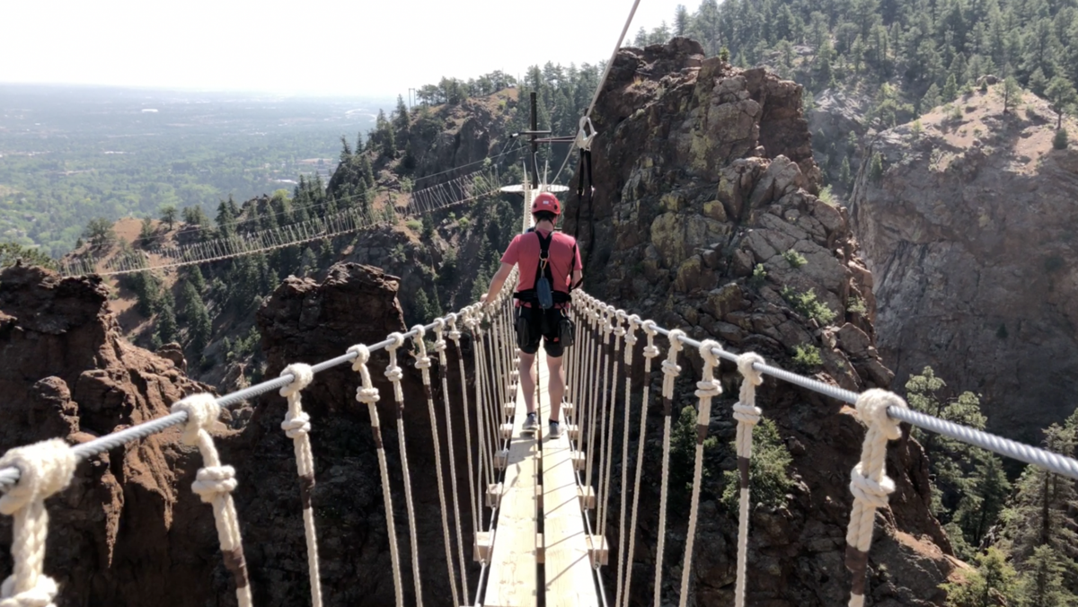 High-flying zipline soars past canyon walls in Colorado mountains