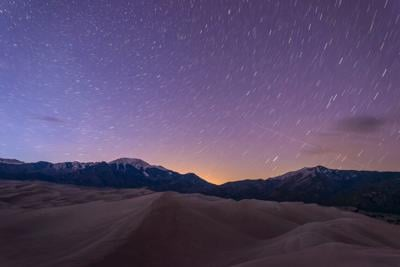Starry night at the Great Sand Dunes National Park & Preserve in Colorado. Photo Credit: SeanXu (iStock).