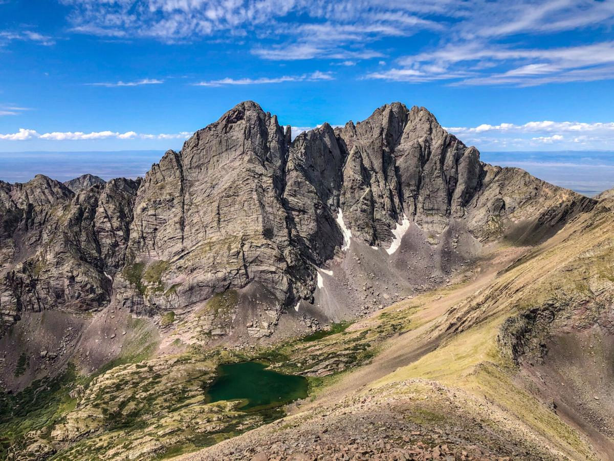 Crestone Needle (left) and Crestone Peak (right) as seen from nearby Humboldt Peak. Photo Credit: Spencer McKee.