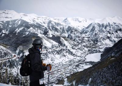 Spencer McKee looks down over the town of Telluride from nearby slopes of Telluride Ski Resort. Photo Credit: Stephen Martin.