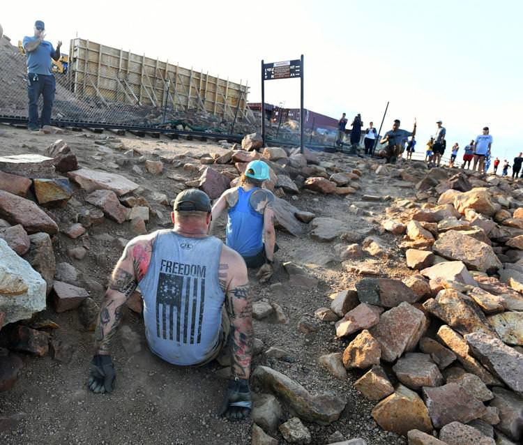 Pair of double-amputees summit 14,115-foot mountain in Colorado