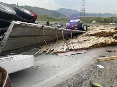 Rolled semi carrying lumber in Colorado (Photo) Courtesy West Metro Fire (via Twitter)