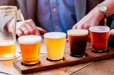 Selection of craft beers in a flight ready for tasting Photo Credit: Daria Nipot (iStock).