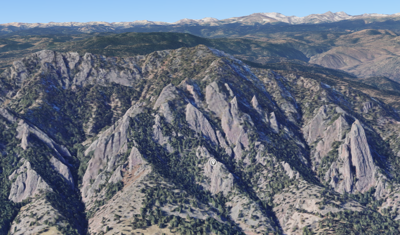 The grey pin drop is on The Regency rock formation, which is found in the area of the Boulder Flatirons. Image Credit: @2021 Google Maps.