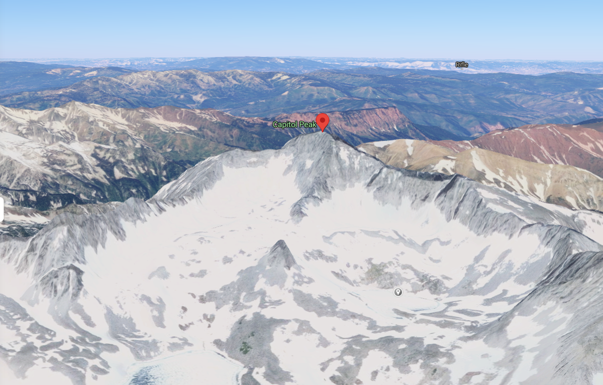 This image shows a 3-D rendering of Capitol Peak, with the summit marked by the red icon. Below the summit (and slightly to the right), find a grey pin. This pin is on the Pierre Lakes location, which is where the search and rescue teams started their ascent from. The Knife Edge ridge can be seen above this, aptly named. Image Credit: @2021 Google Maps.