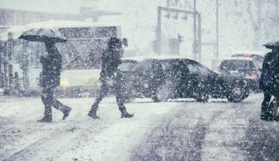 Pedestrians and traffic on a winter day Photo Credit: gremlin (iStock).