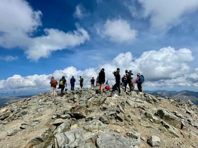 A 'small' crowd gathers on Torreys Peak in Colorado. Many days, crowds can be much larger. Photo Credit: Spencer McKee