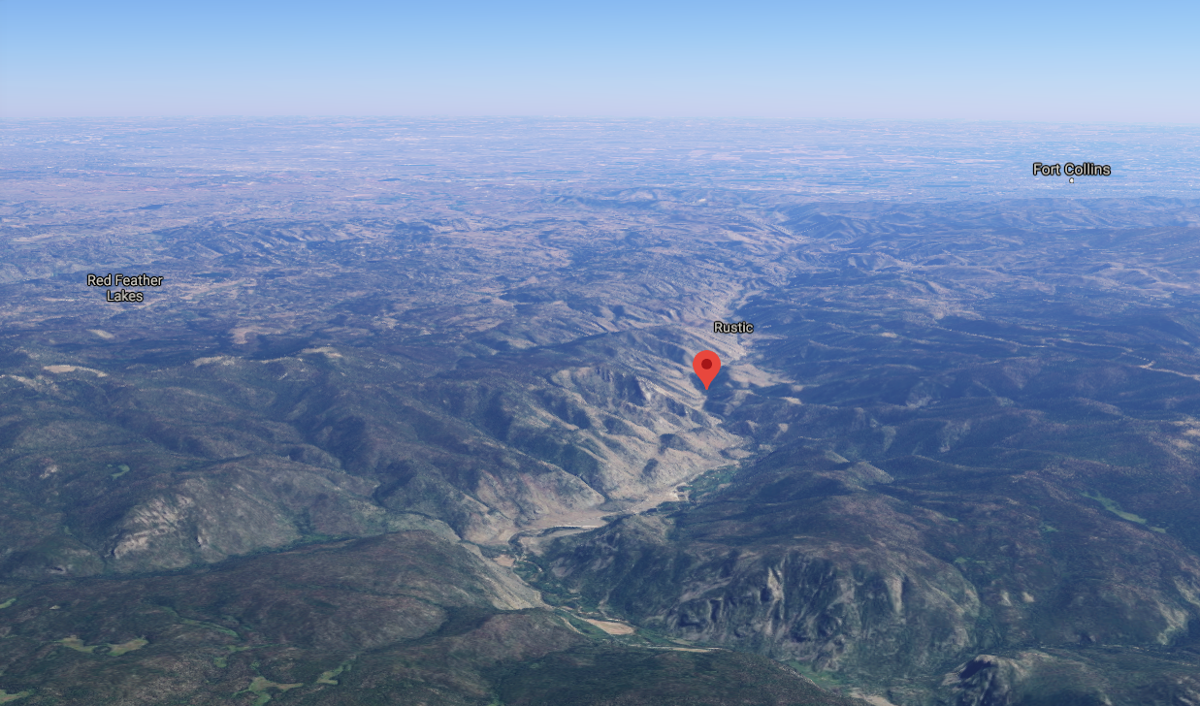 This screenshot from Google Maps indicates the approximate location of Black Hollow Road, where several homes were damaged or destroyed. Note the location of Fort Collins and Red Feather Lakes in the distance, as well as the town of Rustic, to see the approximate location of the Poudre Canyon.