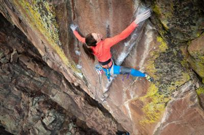 Paige spans the crux move on Vogue (5.14b) outside of Boulder, during her ascent on New Year's Eve in 2019. Photo by Arjan de Kock.