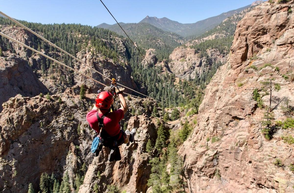 Spencer McKee ziplines on the 'Fins Course' of The Broadmoor's Soaring Adventure experience. Photo Credit: Stephen Martin.