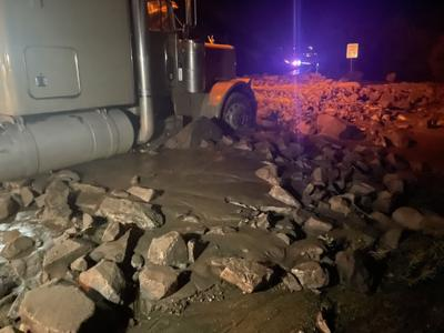A semi stuck in one of the mudslides that took place along Poncha Pass. Photo Credit: Colorado State Patrol.