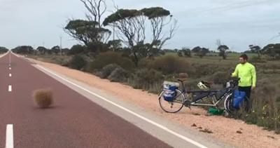 Docs travel world on bike built for two