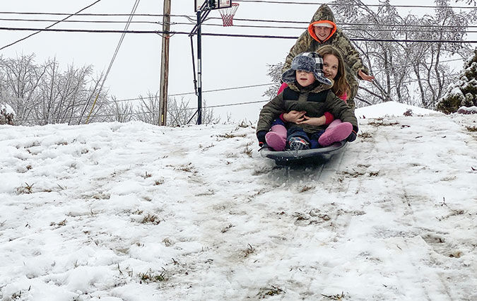 Additional snowfall adds fun to trying week