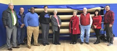 Alumni Association donates floor protection system to Livingston Academy