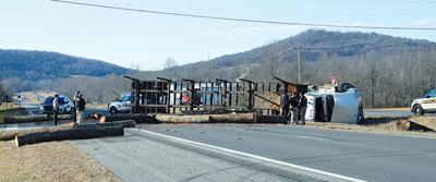 Log truck loses load on Hwy 111