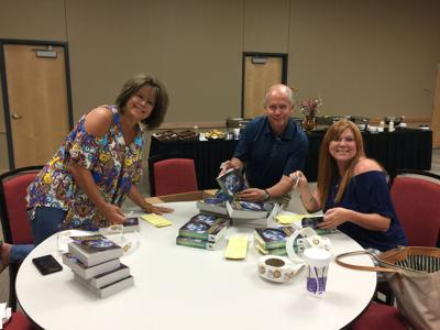 Carthage Rotary Club prepare dictionaries for area third-graders